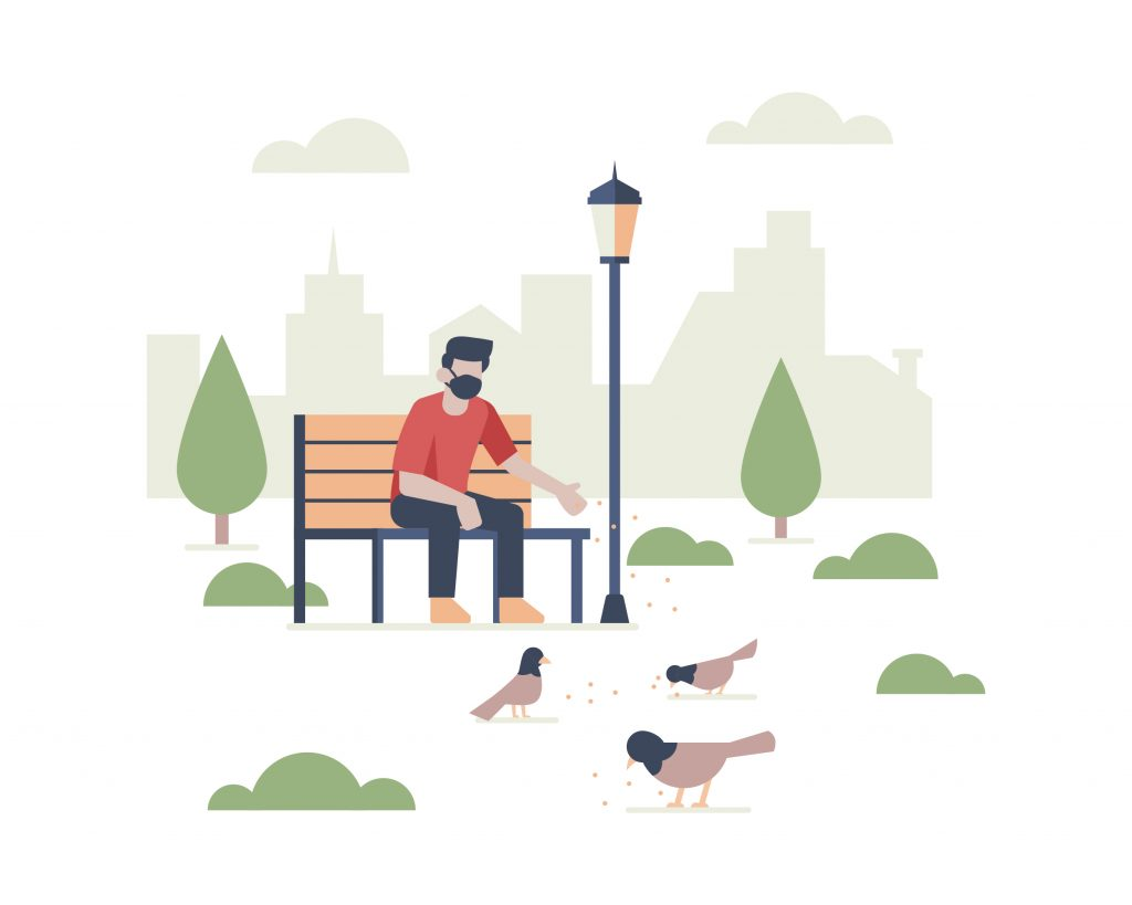 A man wearing a face mask sitting in public park while feeding birds with city building landscape silhouette vector illustration