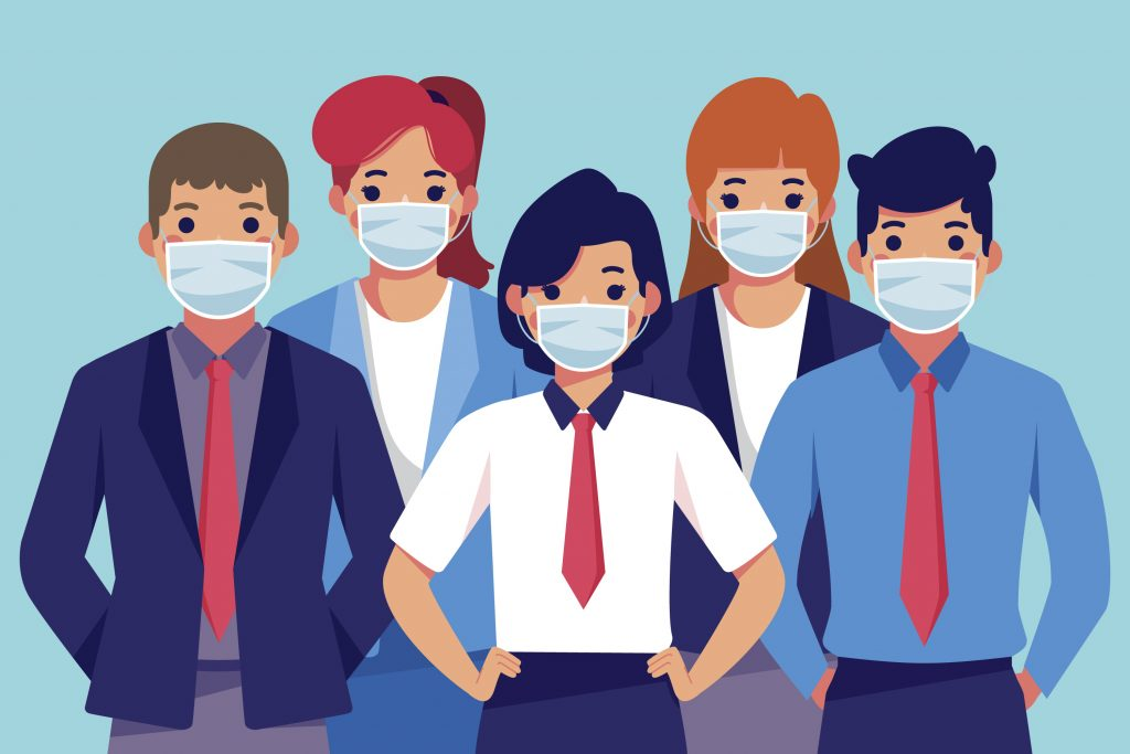 Group of people wearing face masks in professional work attire