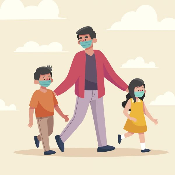 parent walking with his two children and they are all wearing face masks