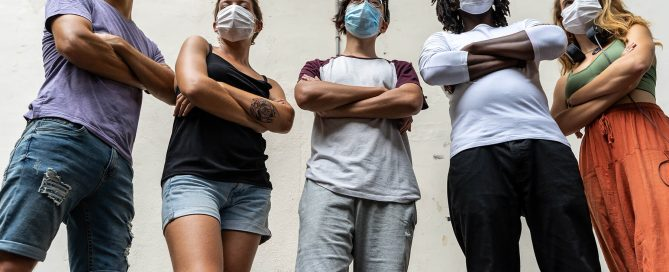 Diverse group of adults with masks